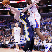 01 February 2014: Utah Jazz shooting guard Gordon Hayward (20) is fouled by Los Angeles Clippers center DeAndre Jordan (6) during the Los Angeles Clippers 102-87 victory over the Utah Jazz at the Staples Center, Los Angeles, California, USA.