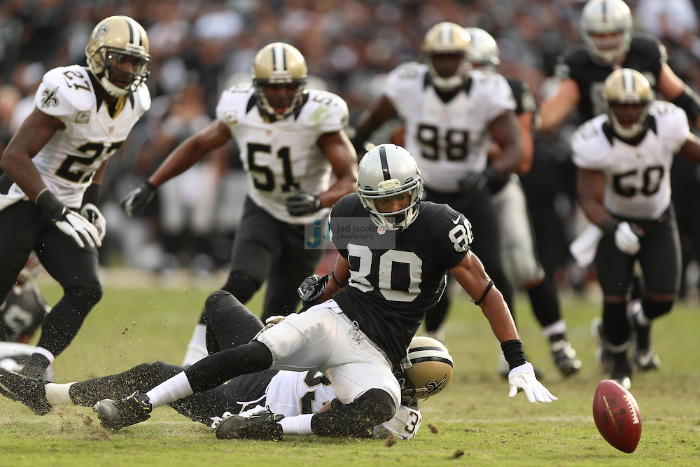 Oakland Raiders wide receiver Rod Streater (80) fumbles against New Orleans Saints cornerback Jabari Greer (33) during an NFL game on Sunday, Nov. 18, 2012 at the Oakland Coliseum in Oakland, Ca. (AP Photo/Jed Jacobsohn)