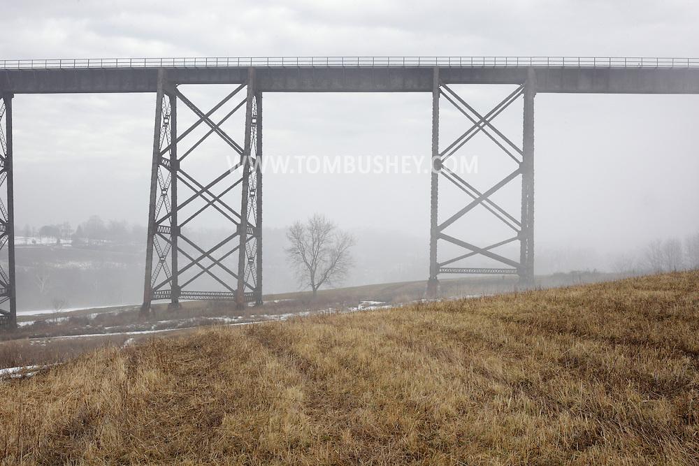 Salisbury Mills, New York -  Fog at the Moodna Viaduct railroad trestle on a warm winter day on Jan. 2, 2010.