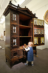 May 19, 2017 - London, London, UK - London, UK. Young toddler child plays in front of a large unusual 18th century George II Palladian 'Baby House' with an estimate of £6,000-9,000. The collection of objects from the Belgravia home of Lord Ballyedmond are presented in the Sotheby's auction house sale which recalls the aristocratic London town house. (Credit Image: © Ray Tang/London News Pictures via ZUMA Wire)
