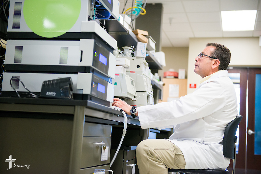 Dr. Uvidelio Castillo, associate professor in the School of Pharmacy at Concordia University Wisconsin in Mequon, Wis., works in the lab on Tuesday, May 27, 2014. LCMS Communications/Erik M. Lunsford