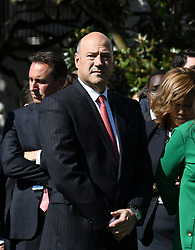 President Donald Trump's chief economic adviser, former Goldman Sachs president Gary Cohn attends a moment of silence with White House staff for the victims of the Las Vegas shooting, on the South Lawn of the White House in Washington, D.C., U.S., Oct. 2, 2017. Photo by Olivier Douliery/ Abaca Press
