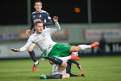 Hibernian's Danny Handling tackled by Falkirk's Blair Alston.<br /> Falkirk 1 v 0 Hibernian, Scottish Championship game played 6/12/2014 at The Falkirk Stadium .