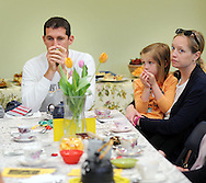 From left, Mike Castello sips tea as Michaela Castello, 4.5 years old, and Danielle Castello of Bedminster, Pennsylvania learn about tea during a Mother's Day Garden Tea Party, which was held indoors due to wet grounds,  Sunday May 8, 2016 at Churchville Nature Center in Churchville, Pennsylvania.  (Photo by William Thomas Cain)