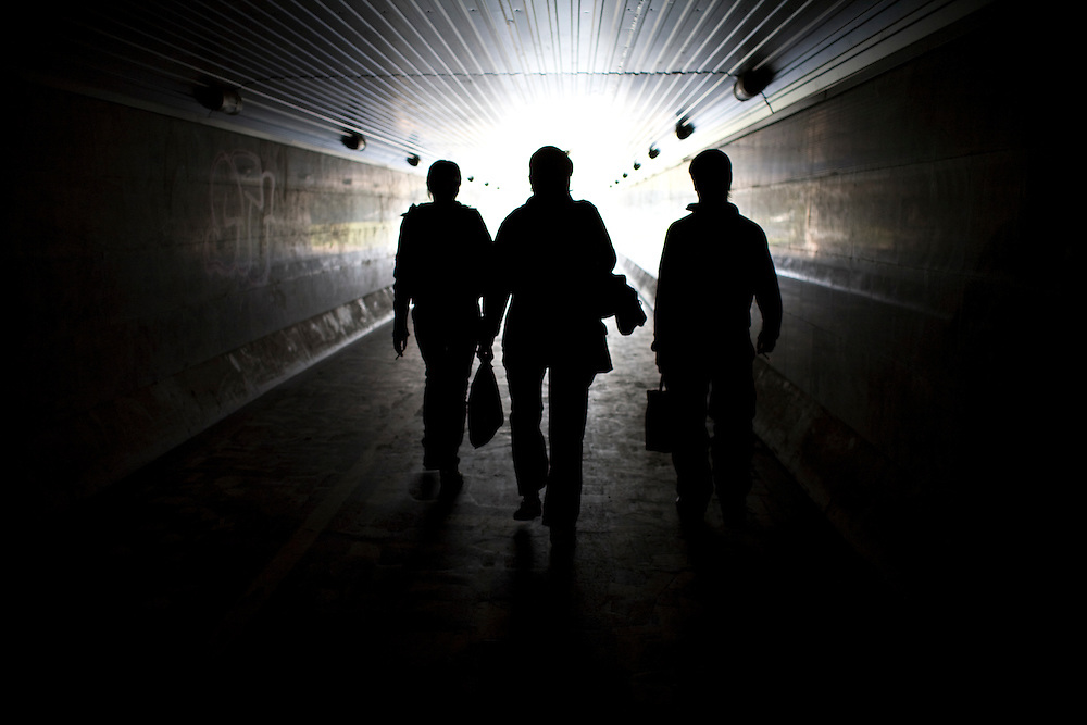 Patients in a rehabilitation program for heroin addiction operated by the NGO Rosa Vetrov walk through a tunnel under the street in Kazan, Russia, on Wednesday, September 26, 2007.