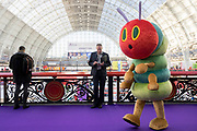 UNITED KINGDOM, London: 22 January 2019. 'The Hungry Caterpillar' character walks past the camera at The Toy Fair 2019 being held at Olympia London this morning. The Toy Fair, which runs between 22nd-24th of January, is the UK's largest toy trade event with over 250 exhibiting companies launching thousands of new products. <br /> Rick Findler / Story Picture Agency