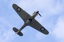 A Hurricane and A Spitfire from the Battle of Britain Memorial Flight flypast late on Saturday afternoon at the Hull Veterans Weekend<br /> <br /> 25-26 July 2015<br />  Image &copy; Paul David Drabble <br />  www.pauldaviddrabble.co.uk