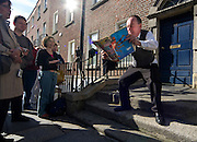 """Editorial Use Only. Bloomsday June  16th 2008, Dublin. Actor Paul O'Hanrahan from Balloonatics theatre company performs the """"Calypso"""" chapter from  James Joyce novel Ulysses around Eccles St. and Dorset Street. In this photo, Bloom is sitting on the """"jakes"""" or toilet"""""""