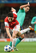 Arsenal midfielder Samir Nasri, challenges for the ball with Barcelona midfielder Xavi Hernandez during a Champions League, round of 16 first leg soccer match between Arsenal and Barcelona at the Emirates stadium in London, UK, Wednesday, Feb. 16, 2011.