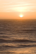 Sunset over the turbulent surf of the Pacific Ocean - San Francisco, California