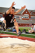 Andrew Hirakawa '12 leaps into the sand pit during the long jump competition at the Midwest Conference Outdoor Championships at Illinois College.