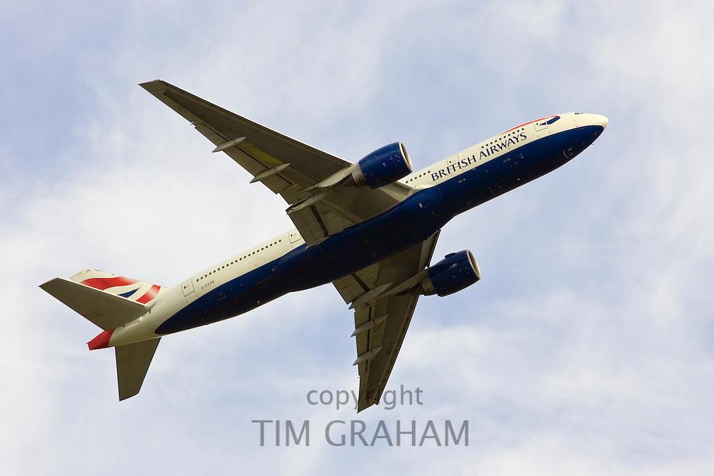 British Airways jet aircraft flying away from Heathrow, London, United Kingdom