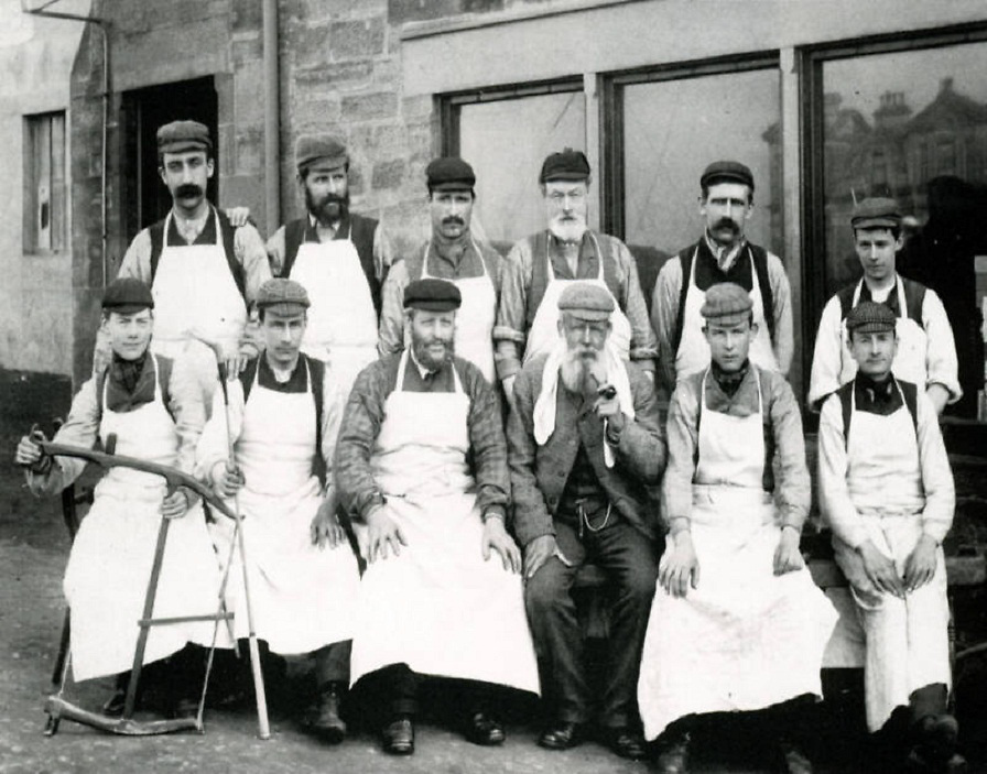 Old Tom Morris pictured outside his golf shop in St Andrews with his Workers 1898.