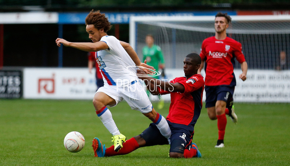 Reise Allassani trying to avade the challenge during the Pre-Season Friendly match between Hampton & Richmond and Crystal Palace at Beveree Stadium, Richmond Upon Thames, United Kingdom on 27 July 2015. Photo by Michael Hulf.