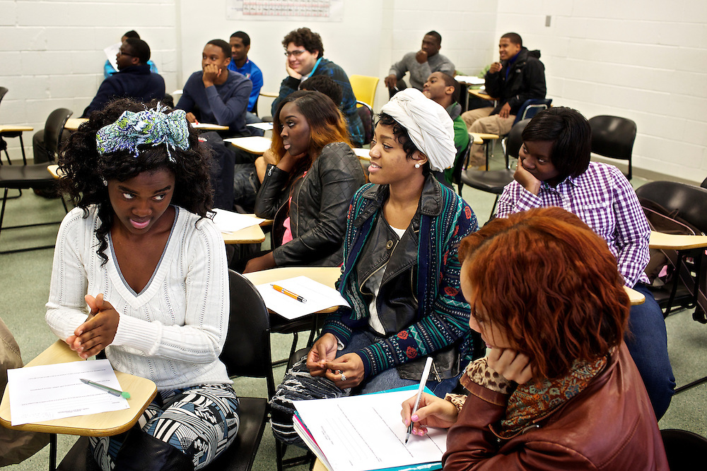 Students at Montgomery College, including Fatmata Kamara, left, begin work on their group final project in their Basic Writing II class at the Takoma Campus on Dec. 11, 2012. If students pass this class, it allows them to progress to the college level english program. Otherwise students will face the decision to take the remedial class again or drop out.