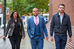 © Licensed to London News Pictures. 21/10/2019. Leeds UK. Left to right Kelly Meadows, Phillip Hoban & Jordan McDonald arrive at Leeds Crown Court this morning. 5 members of Leeds based paedophile hunting group Predator Exposure are appearing at Leeds Crown Court today. Phillip Hoban, Jordan McDonald, Jordan Plain, Dean Walls and Kelly Meadows are all accused of false imprisonment of a man in Chapel Allerton, Leeds. Hoban, 44, McDonald, 18, Plain, 25, and Walls, 51, also denied assaulting same man on same date, Hoban, Meadows, 39, and McDonald denied further charge of false imprisonment of another man in Ackton, near Pontefract.Photo credit: Andrew McCaren/LNP