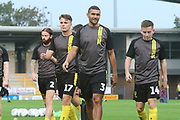 Burton Albion defender Colin Daniel (3) and the Brewers players warm up during the EFL Cup match between Burton Albion and Morecambe at the Pirelli Stadium, Burton upon Trent, England on 27 August 2019.
