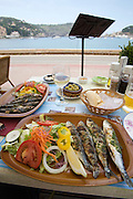 Grilled sardines at a seaside restaurant.