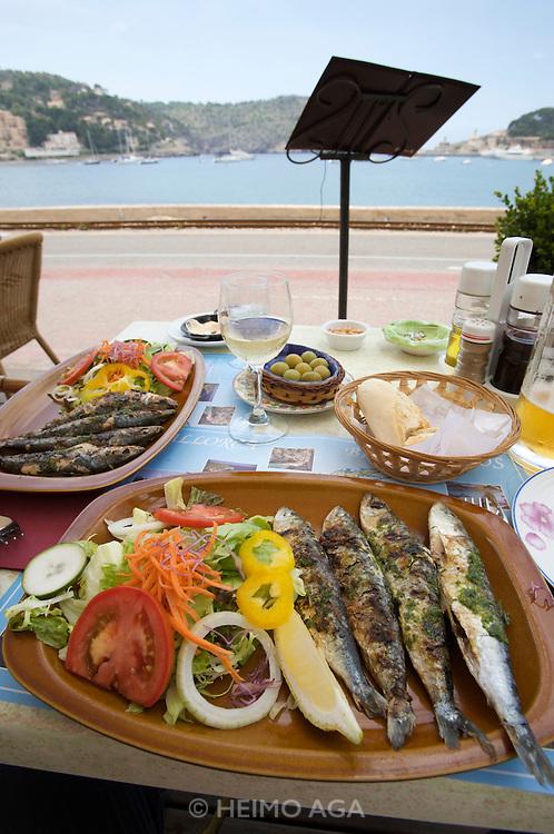 Grilled sardines at a seaside restaurant.