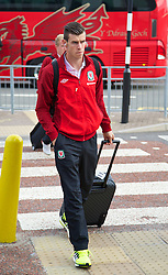 CARDIFF, WALES - Thursday, September 5, 2013: Wales' Gareth Bale arrives at Cardiff Airport as the squad travel to Macedonia ahead of the 2014 FIFA World Cup Brazil Qualifying Group A match. (Pic by David Rawcliffe/Propaganda)