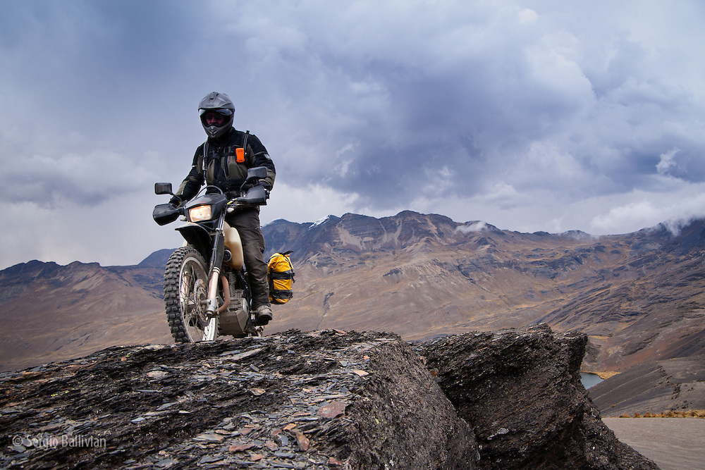 motorcyclist riding at 15,000 ft in the high-altitude Andes near La Paz, Bolivia