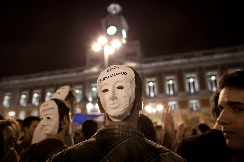 "A man wearing a mask that reads ""I'm thinking"" during a demonstration in Madrid Friday May 20, 2011. Thousands of Spaniards defied a ban on a pre-election demonstration and have mounted a protest camp in the heart of the Spanish capital to express anger at political parties and the country's handling of the economic crisis. The crowds have packed Puerta del Sol square since last Sunday and pledged to stay there until after municipal and regional elections this weekend."
