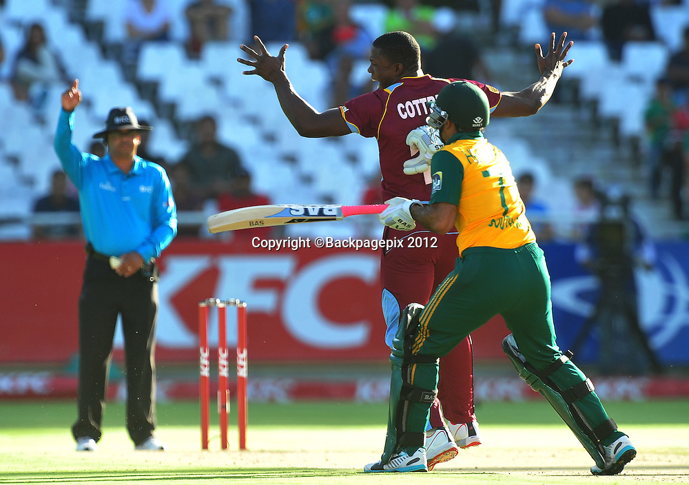 Sheldon Cottrell of the West Indies gets the wicket of Reeza hendricks of South Africa during the 2015 KFC T20 International game between South Africa and the West Indies at Newlands Cricket Ground, Cape Town on 9 January 2015 ©Ryan Wilkisky/BackpagePix