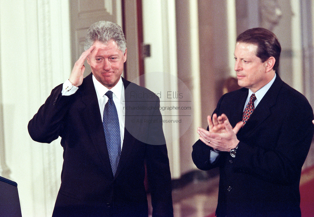 President Bill Clinton with VP Al Gore after unveiling the Year 2000 federal budget February 1, 1999 at a White House ceremony in Washington, DC.