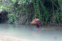 April 27, 2018 - Nikashi, Assam, India - Tribal women fishing in a river with traditional fishing instrument 'Jakoi' (Credit Image: © David Talukdar/Pacific Press via ZUMA Wire)