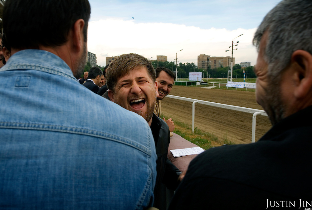 "Chechen President Ramzan Kadyrov celebrates after his horse won the race in Moscow's Hippodrome. .Kadyrov's horse, ""Royal Quiet"", came first in the 1600-metre race. .The horse, born in the U.S.A., is parented by father: Real Quiet, mother: Dinasoar, is trained by S. G. Kolesnikov and rode by master jockey S. V. Petin."