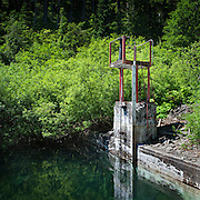 Water level gauge and outlet valve at Bull Run Lake 968m (3,175ft). This is the highest reservoir in the Bull Run Watershed and is celebrated for the high purity of its water. This is the origin of Portland's drinking water, which flows by gravity to the Mount Tabor reservoirs before entering the City's water distribution network.