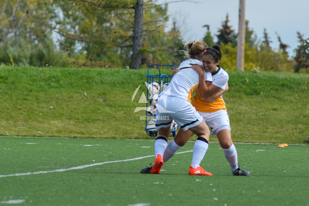 3rd year forward Brianna Wright (7) of the Regina Cougars  celebrates with 4th year midfielder Shayla Kapila (13) after scoring the equalizing goal during the 31st minute of the Women's Soccer Homeopener on September 10 at U of R Field. Credit: Arthur Ward/Arthur Images