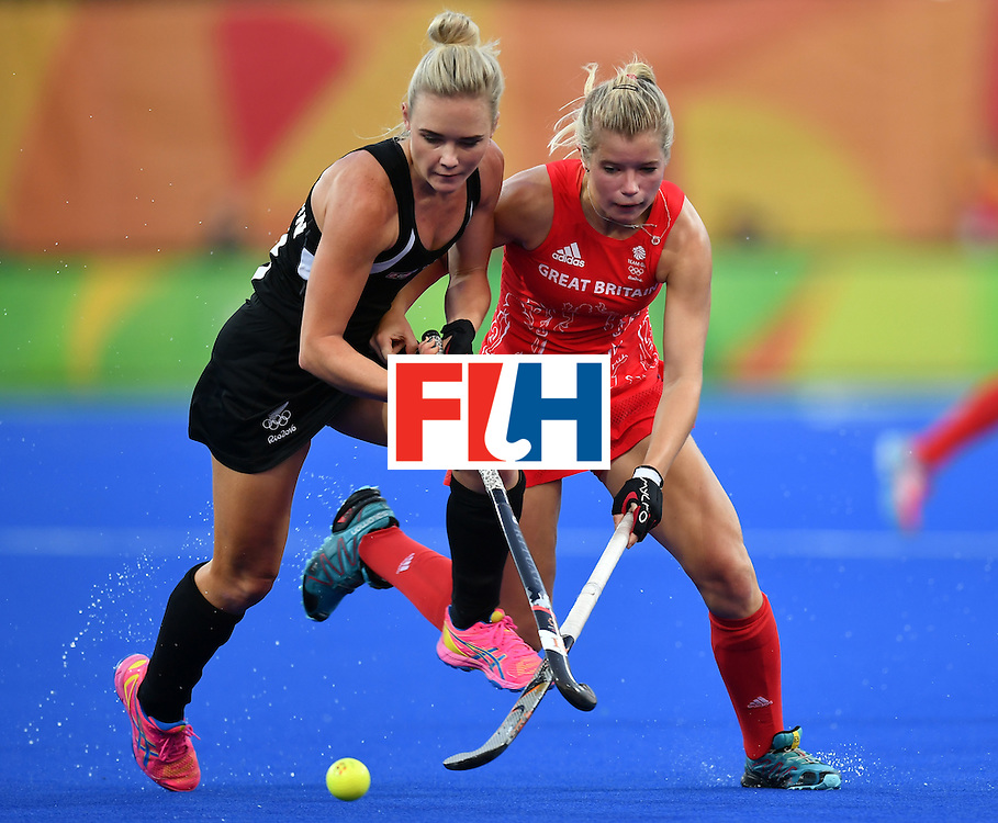 New Zealand's Charlotte Harrison (L) vies with Britain's Sophie Bray during the women's semifinal field hockey New Zealand vs Britain match of the Rio 2016 Olympics Games at the Olympic Hockey Centre in Rio de Janeiro on August 17, 2016. / AFP / MANAN VATSYAYANA        (Photo credit should read MANAN VATSYAYANA/AFP/Getty Images)