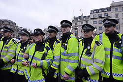 © Licensed to London News Pictures. 13/04/2013. London, UK. Police faces protesters during an anti-Thatcher demonstration at Trafalgar square on April 13, 2013 in London. Thousands of people gather for a party to celebrate the death of former Prime Minister Margaret Thatcher..Photo credit : Peter Kollanyi/LNP