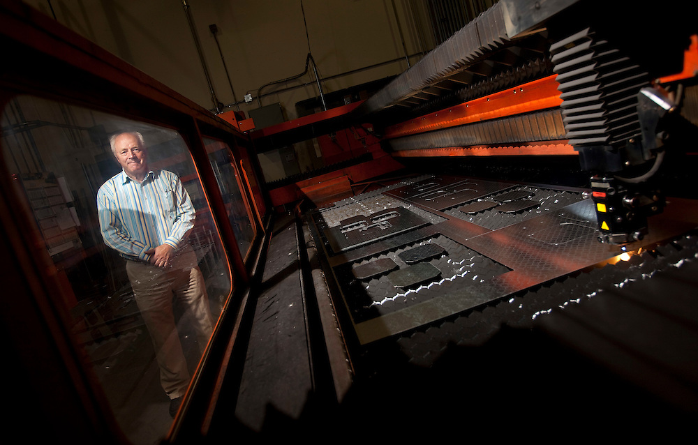 London, Ontario.: April 15, 2011 --  Jan Maarschalkerweerd, President of Abuma Manufacturing limited stands with a laser cutter at their London, Ontario plant, April 15, 2011.<br /> (GEOFF ROBINS for National Post)
