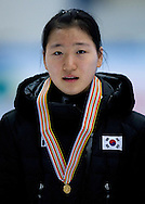 Noh Do Hee of South Korea with gold medal in the Women's 1500 Meters on day one of the 2013 ISU Short Track Speed Skating Junior World Championships at Torwar Ice Hall on February 22, 2013 in Warsaw, Poland...Poland, Warsaw, February 22, 2013...Picture also available in RAW (NEF) or TIFF format on special request...For editorial use only. Any commercial or promotional use requires permission...Photo by © Adam Nurkiewicz / Mediasport