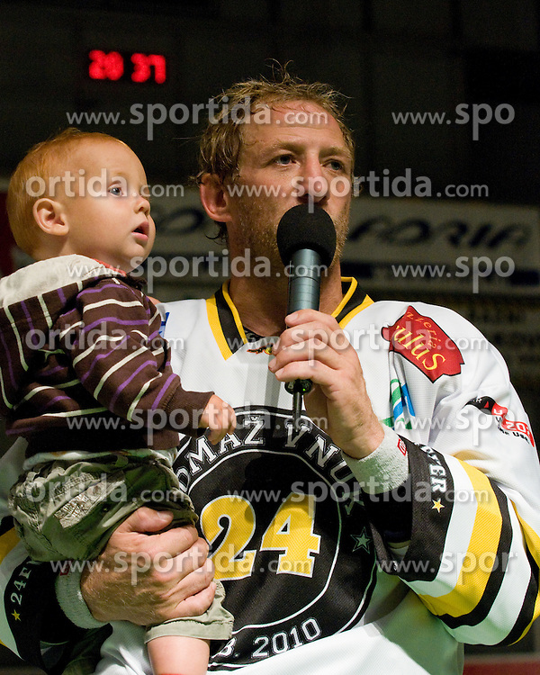 Tomaz Vnuk with his child talking to fans in Tomaz Vnuk's exhibition game between team HDD Tilia Olimpija and team 24 Ever on August 28, in Ljubljana, Slovenia. (Photo by Matic Klansek Velej / Sportida)