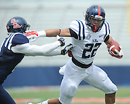 Jordan Wilkins (22) is tackled by Chief Brown (8) at Mississippi's Grove Bowl controlled scrimmage at Vaught-Hemingway Stadium in Oxford, Miss. on Saturday, April 5, 2014. (AP Photo/Oxford Eagle, Bruce Newman)