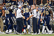 ST. LOUIS, MO - SEPTEMBER 11:   Head Coach Steve Spagnuolo celebrates with Steven Jackson #39 of the St. Louis Rams after a touchdown against the Philadelphia Eagles at the Edward Jones Dome on September 11, 2011 in St. Louis, Missouri.  The Eagles defeated the Rams 31 to 13.  (Photo by Wesley Hitt/Getty Images) *** Local Caption *** Steve Spagnuolo; Steven Jackson