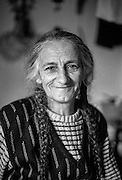 """Nana"" (Bosnian: Grandmother), a female refugee from Bosnia sitting for a portrait at the Varazdin refugee camp in Croatia in the winter of 1992."