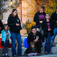 102713  Adron Gardner/Independent<br /> <br /> Visitors pause for a prayer at a domestic violence candlelight vigil at the McKinley County Courthouse in Gallup Sunday.