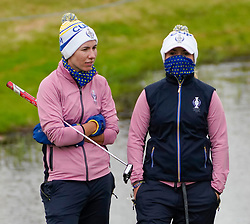 Auchterarder, Scotland, UK. 14 September 2019. Saturday morning Foresomes matches  at 2019 Solheim Cup on Centenary Course at Gleneagles. Pictured; Carlota Ciganda  (l) and Bronte Law of Team Europe in warm clothing to protect against cold weather. Iain Masterton/Alamy Live News