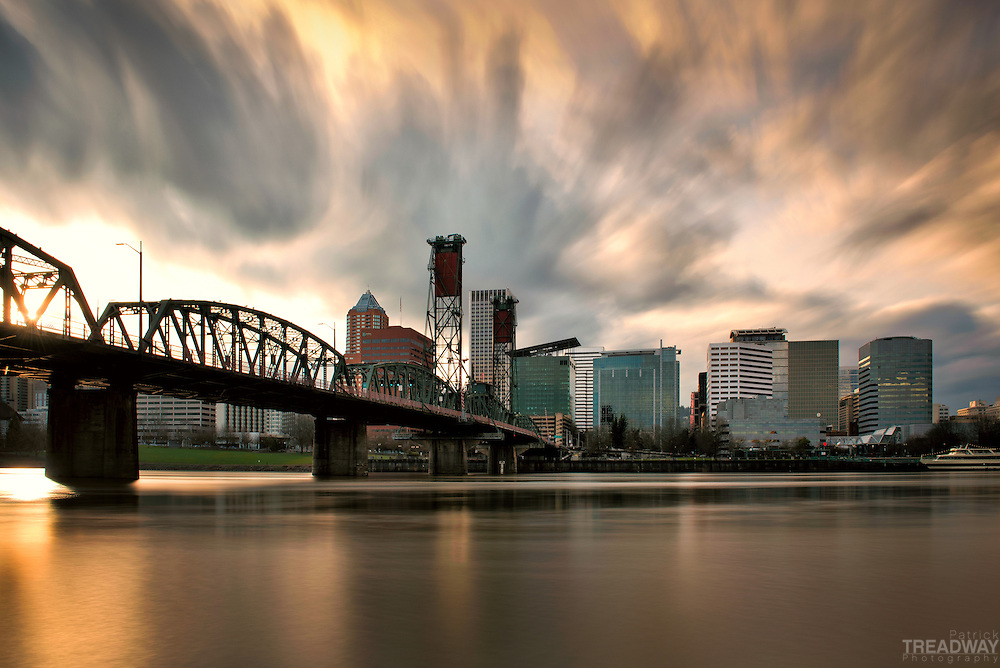 A long exposure of a Portland sunset with the Hawthorne Bridge and downtown visible.