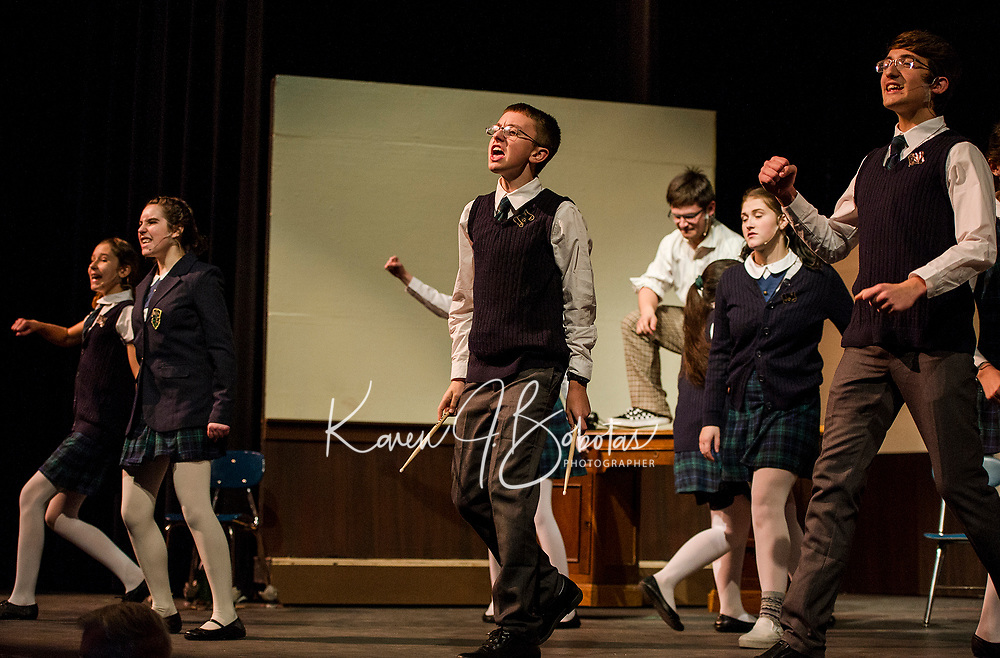 """Freddy"" Jesse Powers rocks out with his classmates during dress rehearsal for School of Rock at Gilford High School on Tuesday evening.  Karen Bobotas/for the Laconia Daily Sun)"