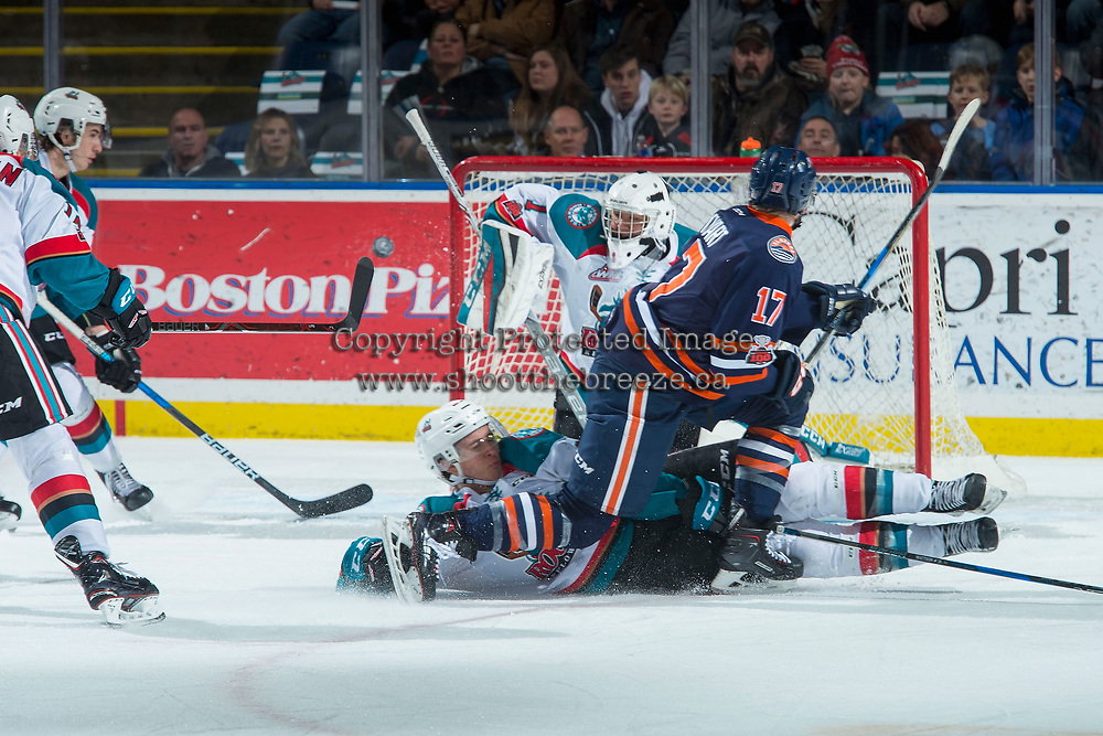 KELOWNA, CANADA - DECEMBER 27: Brodi Stuart #17 of the Kamloops Blazers is blocked by Conner Bruggen-Cate #20 as James Porter #1 of the Kelowna Rockets makes a first period save on December 27, 2017 at Prospera Place in Kelowna, British Columbia, Canada.  (Photo by Marissa Baecker/Shoot the Breeze)  *** Local Caption ***