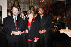 Left to right, TIM & CATHY HERRING and JOHNNY EKPERIGIN at a party to celebrate the 40th anniversary of Julie's Bar & Restaurant, 135 Portland Road, London W11 on 18th November 2010.