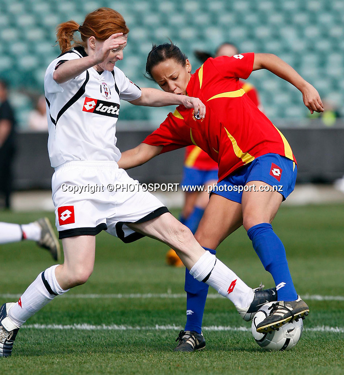Sarah Gregorious keeps the ball away from Westerns Rachel Oliver.<br />