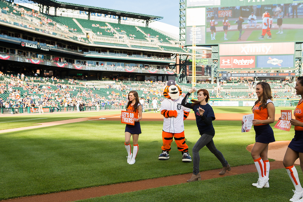 Alie Ward throwing out the first pitch at a Detroit Tigers game while promoting The Henry Ford and The Henry Ford's Innovation Nation