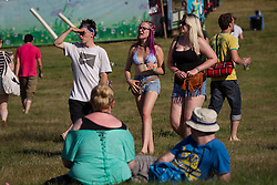 Image ©Licensed to i-Images Picture Agency . 17/07/2014 . Henham Park , Suffolk , United Kingdom. People enjoy the heat as temperatures soar in to the late 20s degrees centigrade in Suffolk at The Latitude Festival of music and arts . Picture by Joel Goodman/i-Images