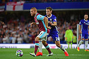West Ham United midfielder Gokhan Tore (17) holds off Chelsea defender Cesar Azpilicueta (28) during the Premier League match between Chelsea and West Ham United at Stamford Bridge, London, England on 15 August 2016. Photo by Jon Bromley.
